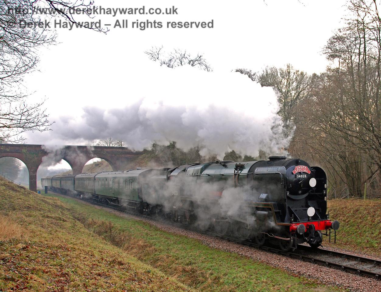 34028 Eddystone steams north from Three Arch Bridge. 22.12.2007