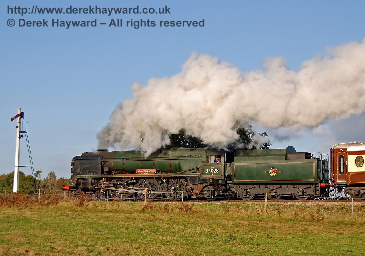 34028 Eddystone steams north past the Sheffield Park Advance Starter. 20.10.2007