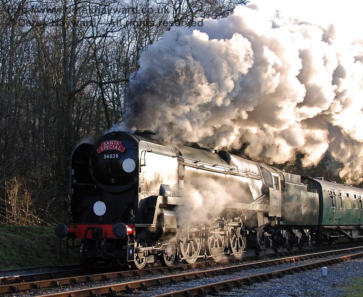 34028 Eddystone steams north from Horsted Keynes. 16.12.2007