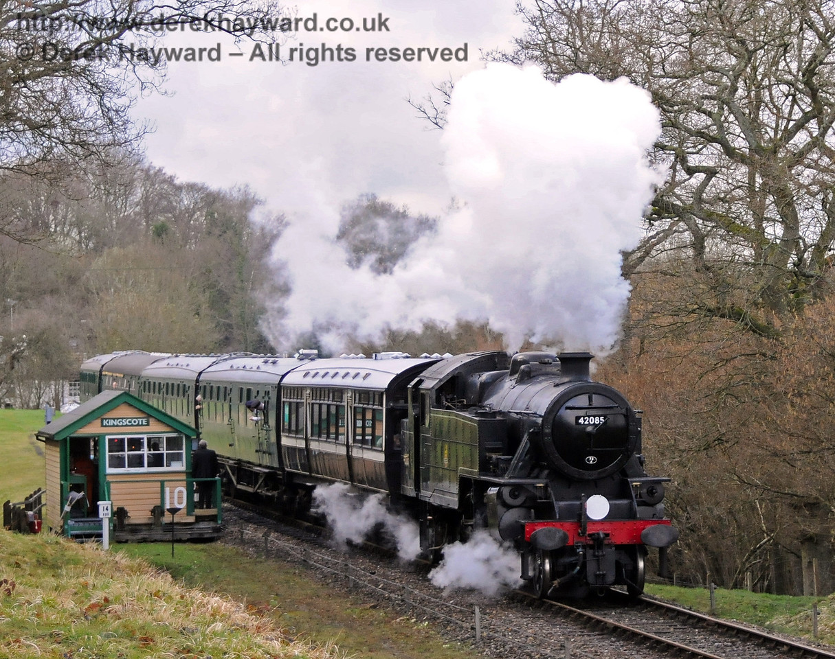 42085 steams away from the Kingscote signal box.  27.03.2010  1738