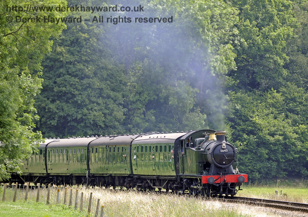 5643 steams north from Three Arch Bridge.  26.07.2014  9893