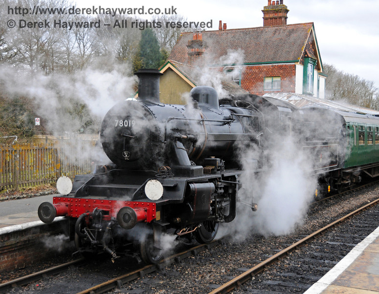 A combination of cold air and drizzle causes the steam to hang around 78019 at Kingscote.  13.02.2010