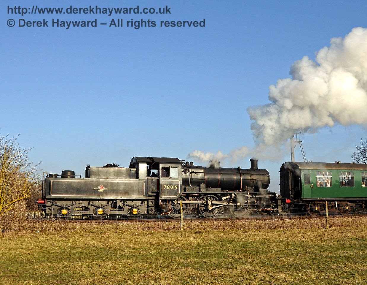 78019 glints in the sun as it steams north from Sheffield Park. 06.02.2010