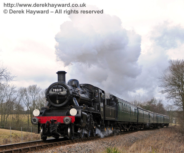 78019 steam south towards New Coombe Bridge.  13.02.2010
