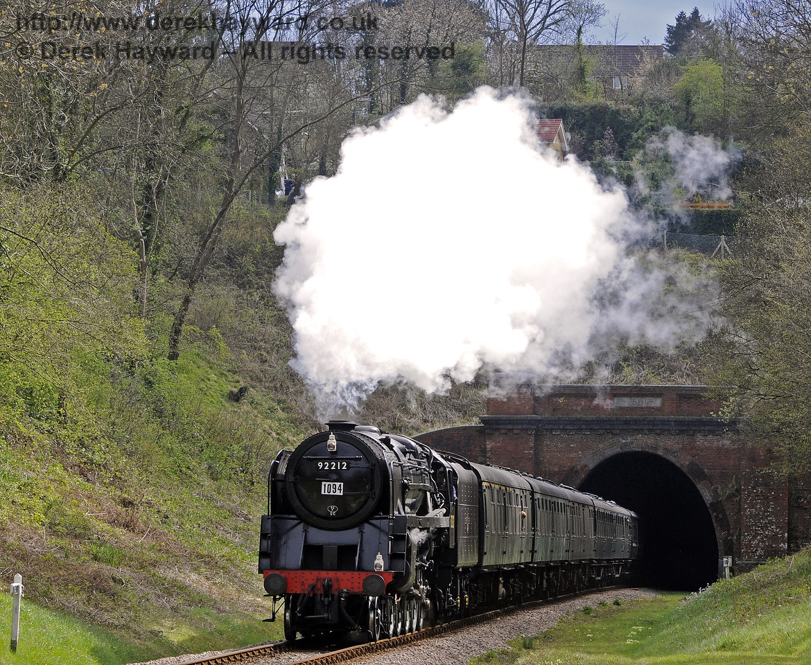 92212 emerges from West Hoathly Tunnel.  15.04.2012  7804