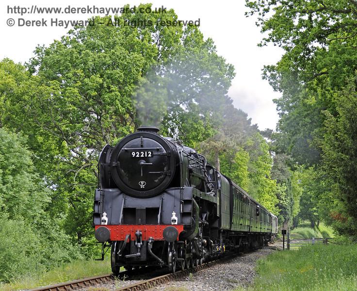 92212 steams across Birch Farm Crossing.  09.06.2013  7245