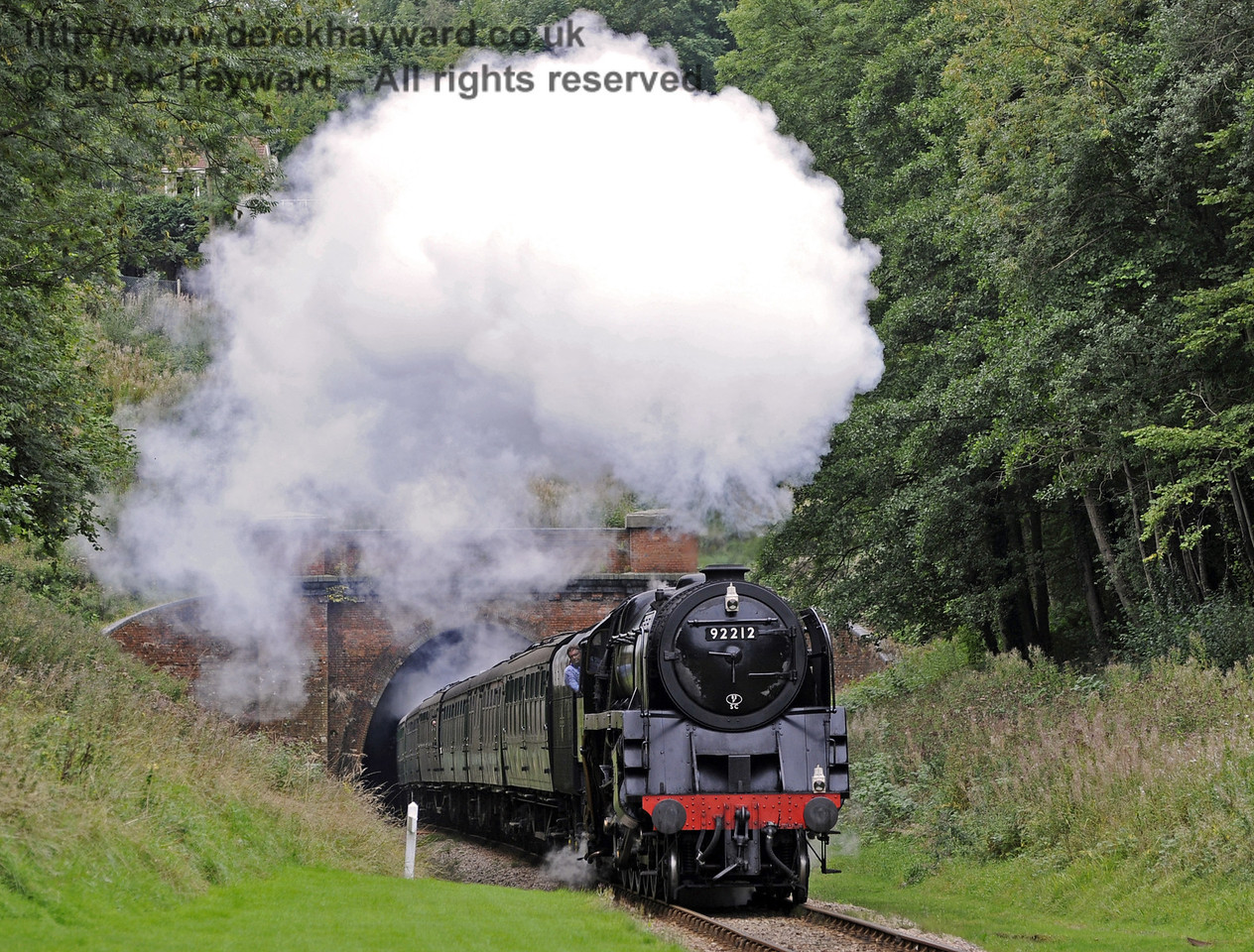 92212 gives a steam display as it leaves West Hoathly Tunnel.  22.09.2013  8060