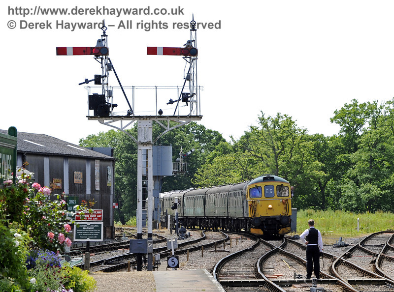 33103 Swordfish approaching Horsted Keynes.  the signalman stands ready to exchange the tokens.  30.06.2013  7570