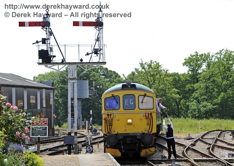 33103 Swordfish arriving at Horsted Keynes, with the signalman exchanging tokens.  30.06.2013  7575