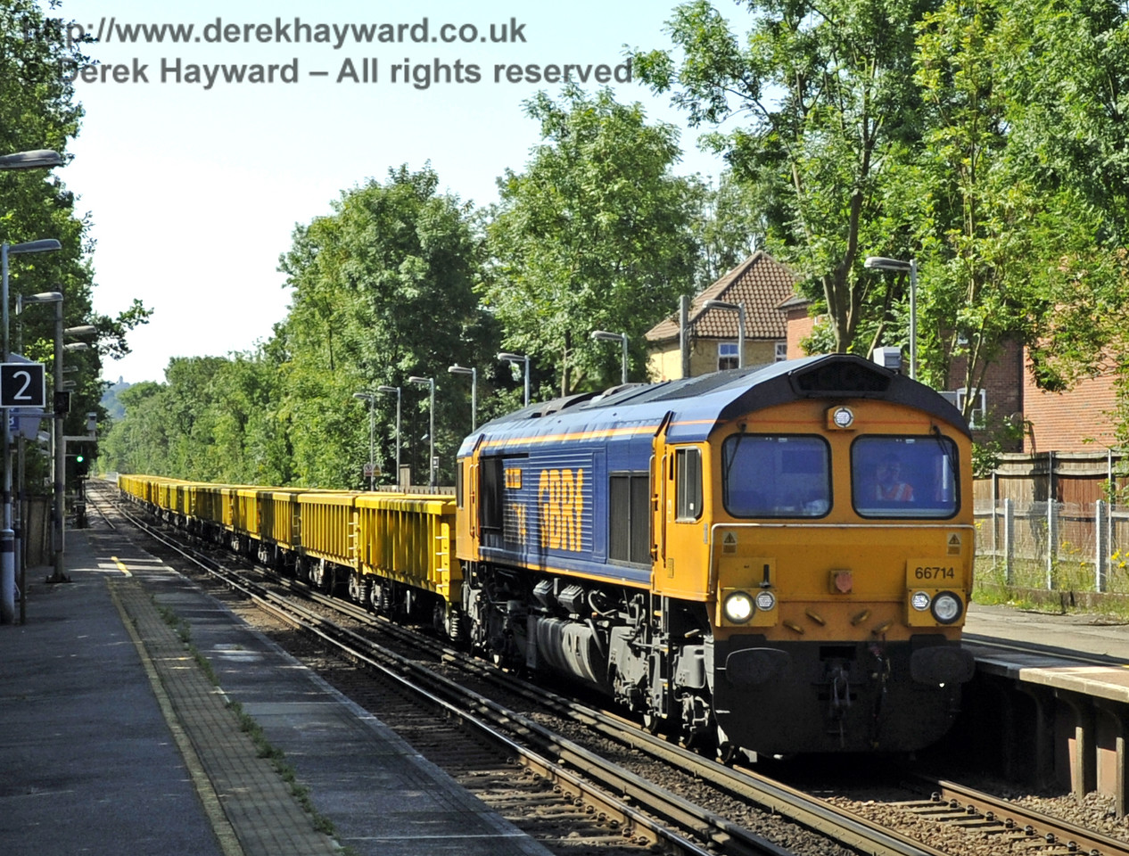 66714 hauling the empty stock of a Bluebell waste train, en route from Tonbridge Yard to East Grinstead.  The train is seen at Dunton Green Station, Kent.  04.07.2011  2223