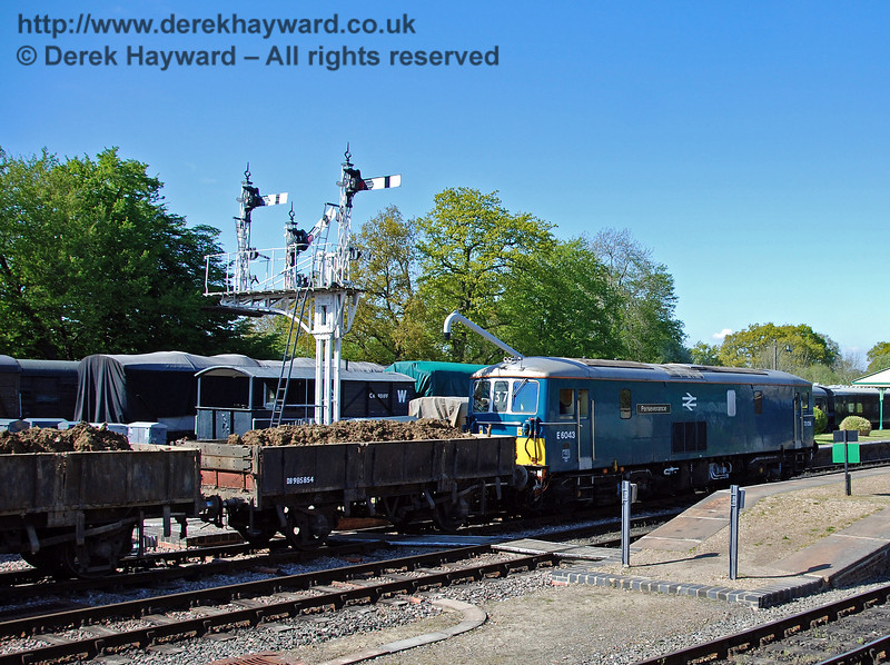 A sight you don't see often. The signal for the Ardingly Branch (siding) is cleared as 73136 (E6043) pushes the loaded spoil train back to the work site for unloading. 29.04.2009