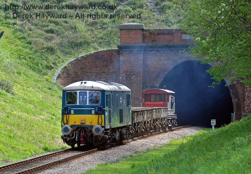 73136 (E6043) emerges from West Hoathly tunnel with the empty spoil train, ready for another round trip. 29.04.2009
