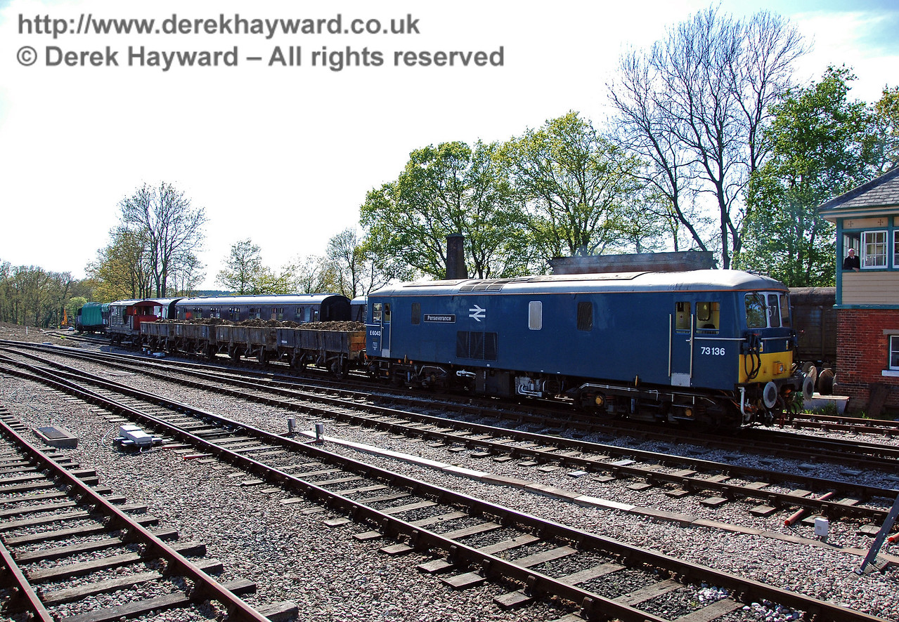 73136 (E6043) pushes the train towards the Ardingly siding, as the signalman watches from the box. 29.04.2009