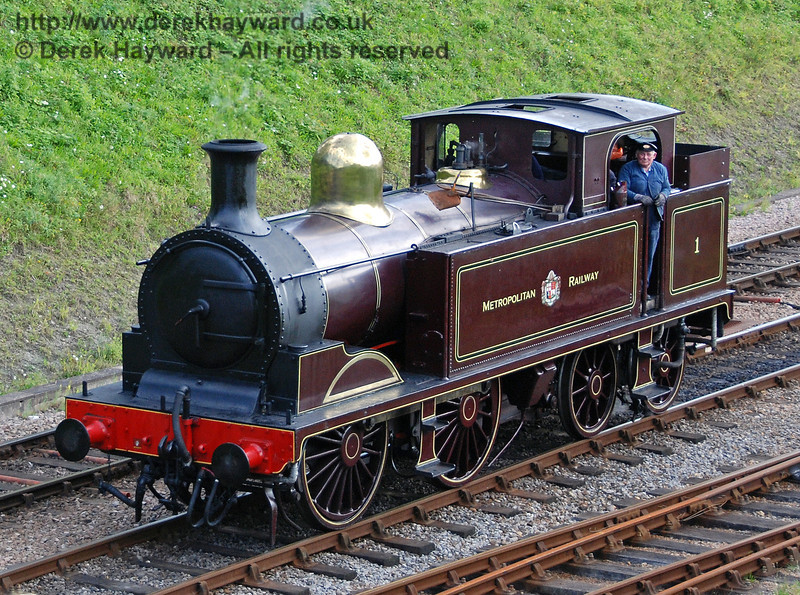 A member of the crew looks to camera as Metropolitan Railway No.1 runs round at Horsted Keynes. 28.07.2007