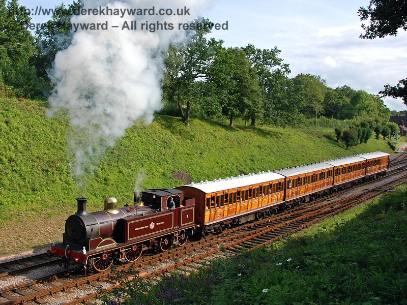 Metropolitan Railway No.1 and the Metropolitan coaches steam north from Horsted Keynes 28.07.2007