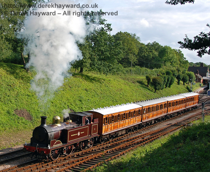 Metropolitan Railway No.1 and the Metropolitan coaches leave Horsted Keynes. 28.07.2007