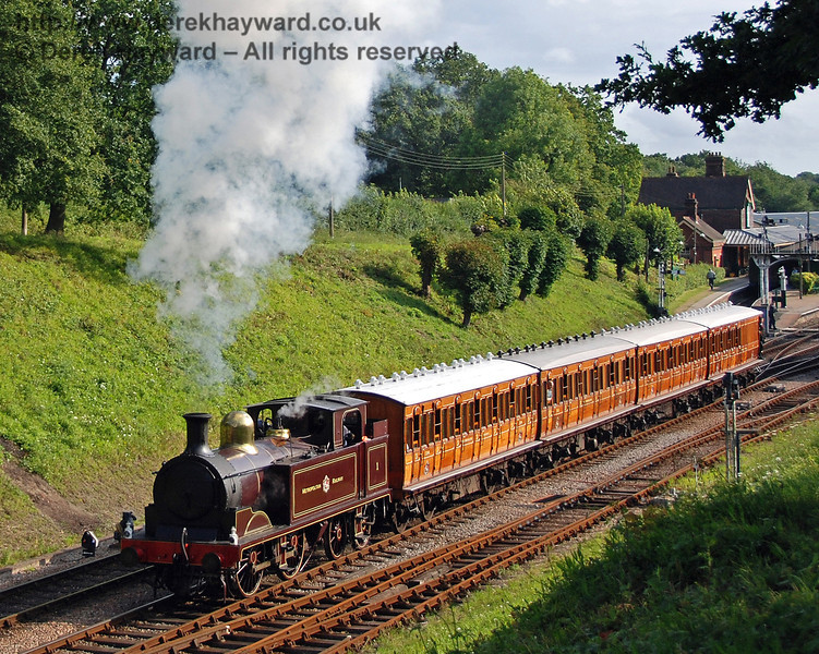 Metropolitan Railway No.1 and the Metropolitan coaches draw north out of Horsted Keynes. 28.07.2007