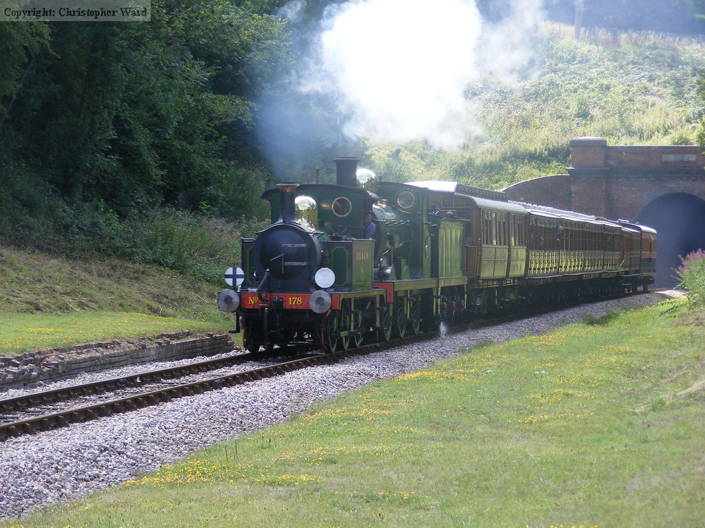 The two SECR engines battle north with a long train