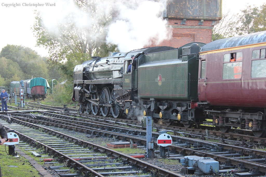 70013 draws through the station on arrival into the sidings to take on water