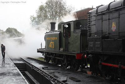 The E4 sits in the yard as the 9F backs onto its stock