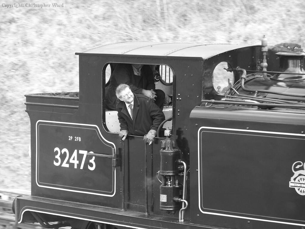 The fireman of 32473 checks the train