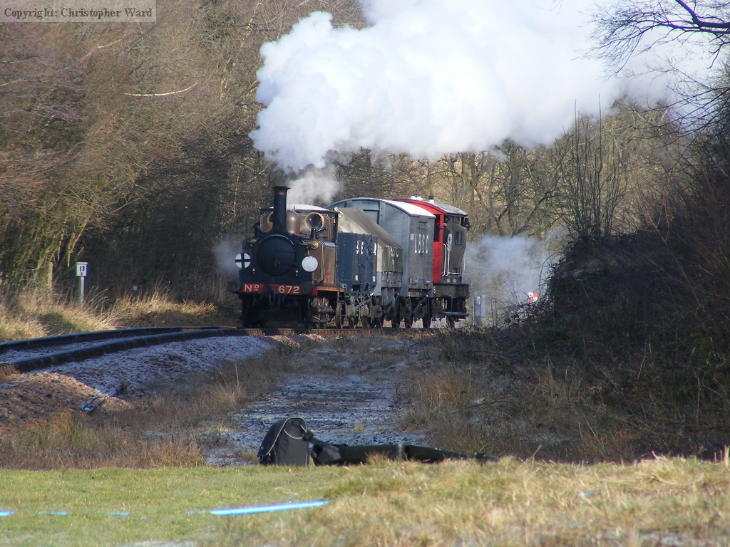 With a short freight in tow, 672 heads south