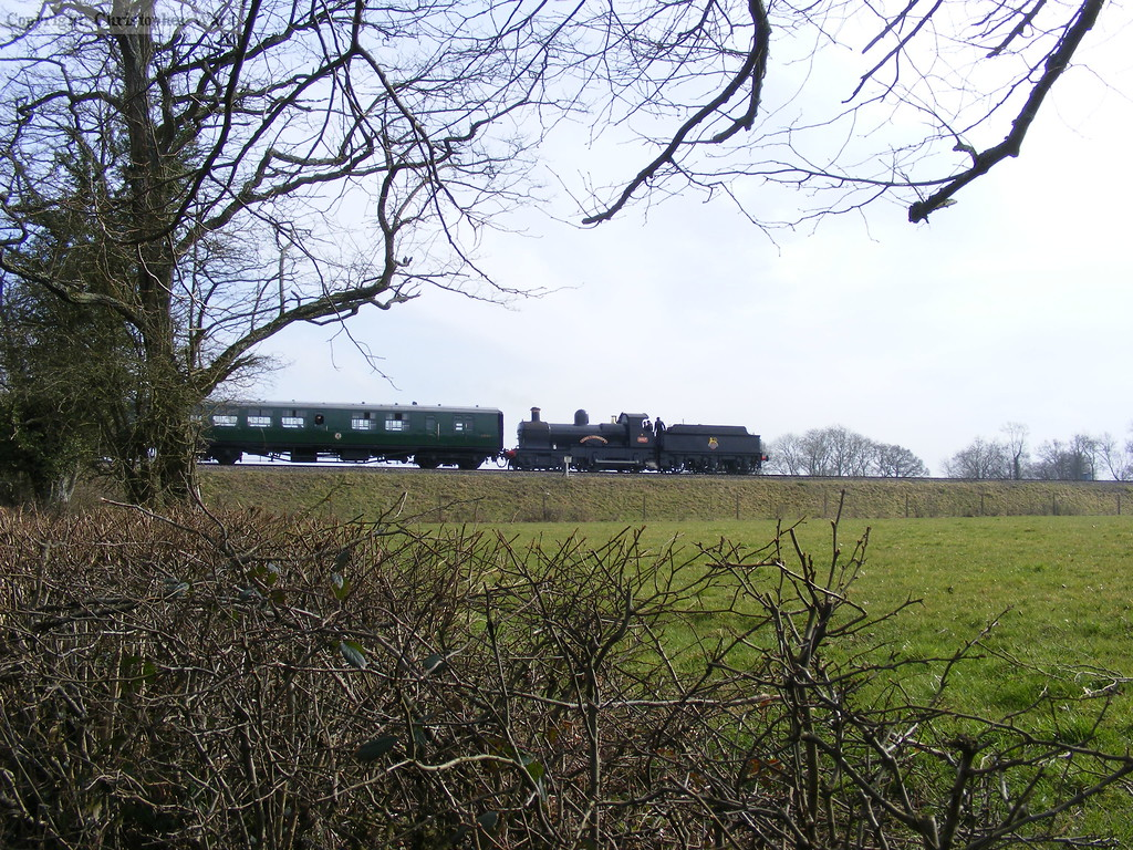 9017 heads south with four Bulleid carriages in tow