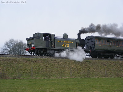 A wisp of steam from the injector as B473 slows for the signal