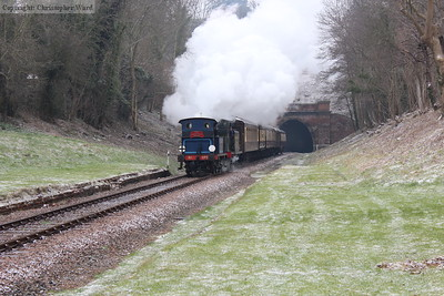 Snow on the ground as the morning Pullman passes through the old station