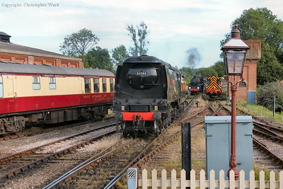 A busy scene at the south end of the station. 34092 draws off her train, as the 09 idles waiting to attach to the stock and draw it into the siding. Meanwhile, 73082 waits for permission to leave with the goods.