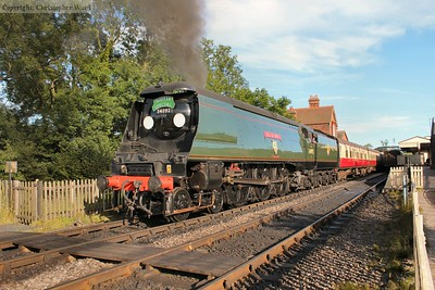 34092 City of Wells heads off into the evening sun