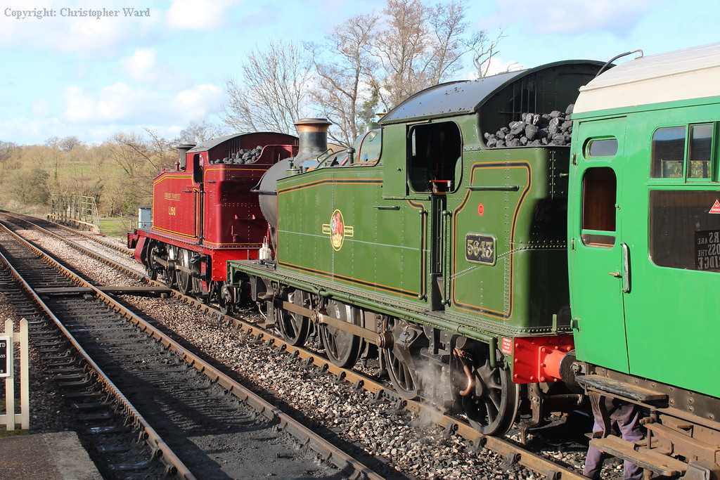 The tank engines sit in the sun