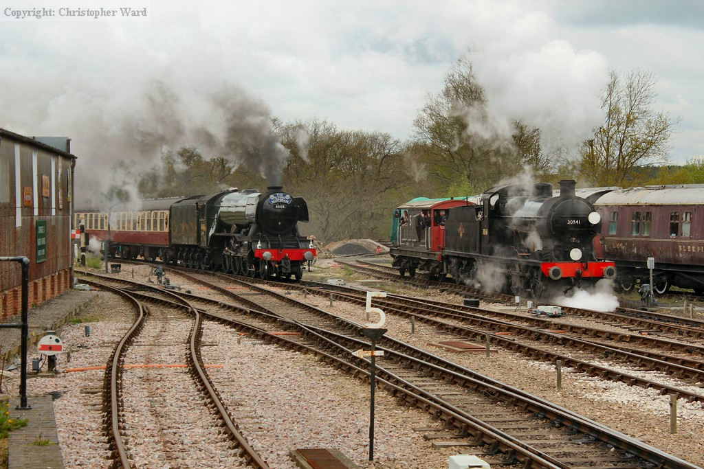 Flying Scotsman approaches as the Q gets underway to parallel through the station