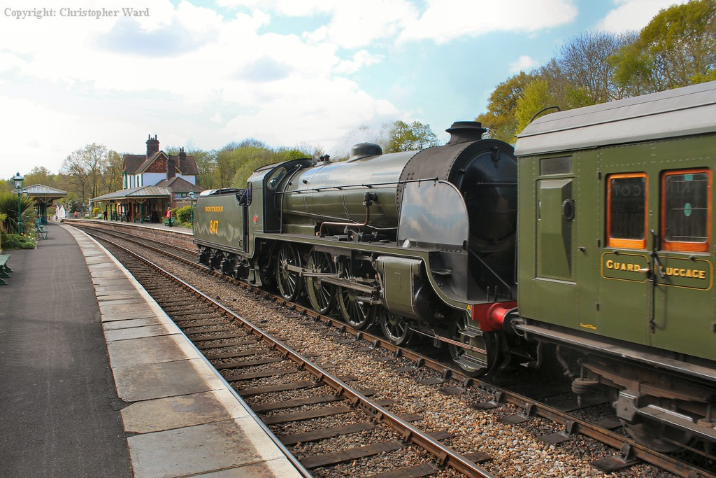 The S15 enters Kingscote station with the Southern Railway coaches