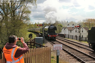 A steward gets his shot of 60103 on her way through
