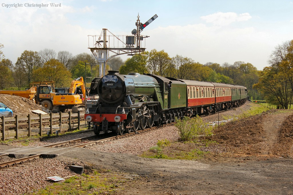 60103 passes the down yard and inner home on the approach to the station