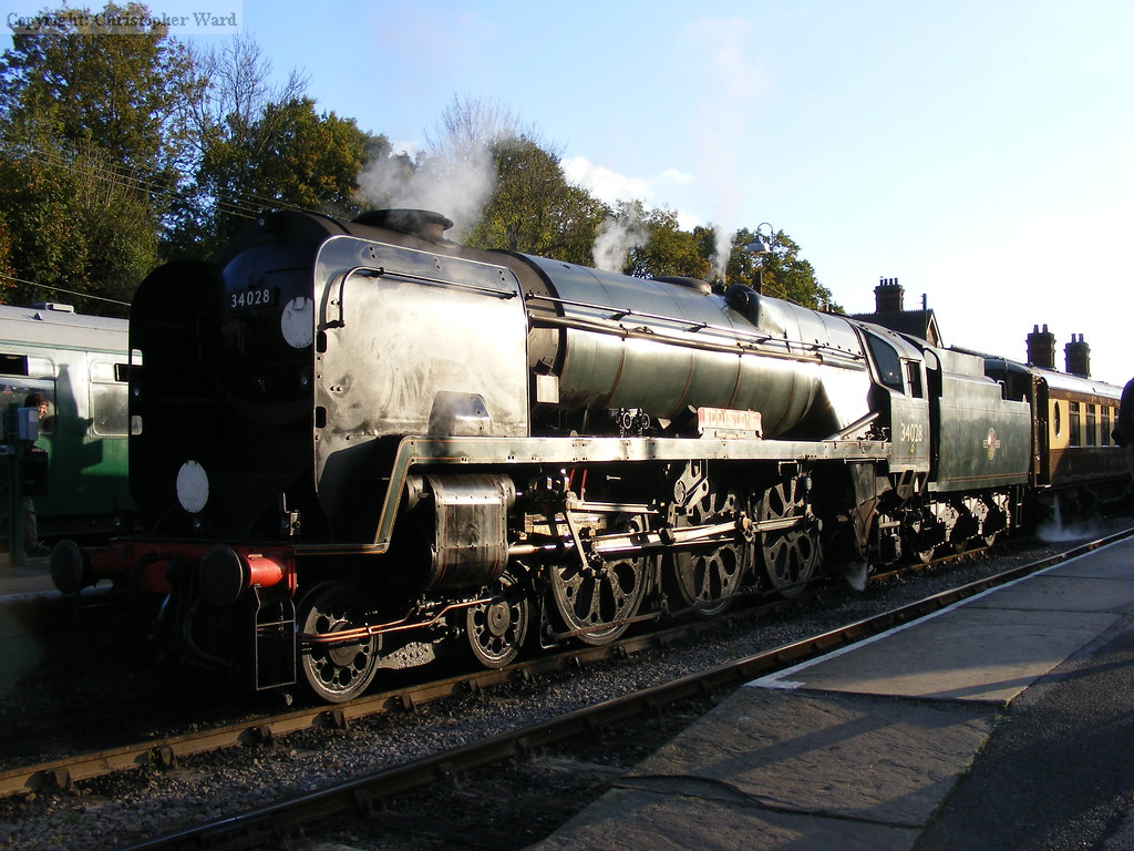 34028 glints in the sun at Horsted Keynes with a Pullman working