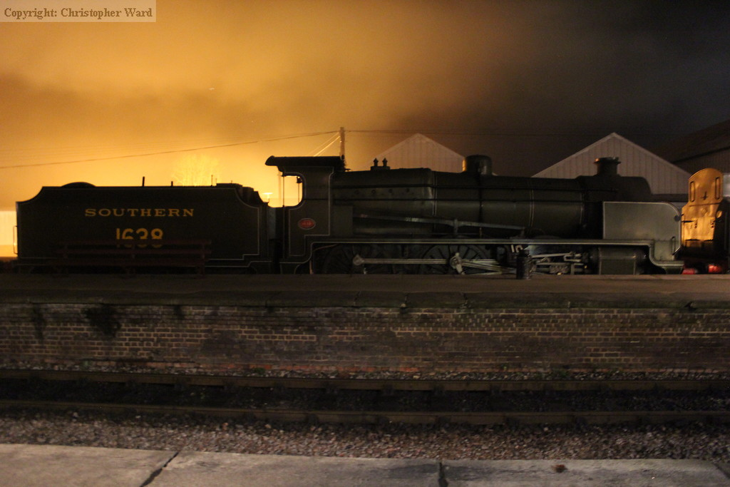 Sadly the orange glow above the cab of 1638 emanates not from a fire in her belly but a security light in the industrial units behind