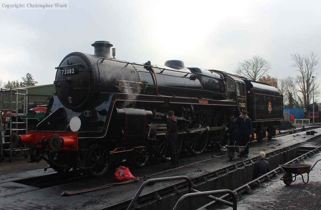The yard crew complete their tasks as the BR Standard prepares to move off-shed