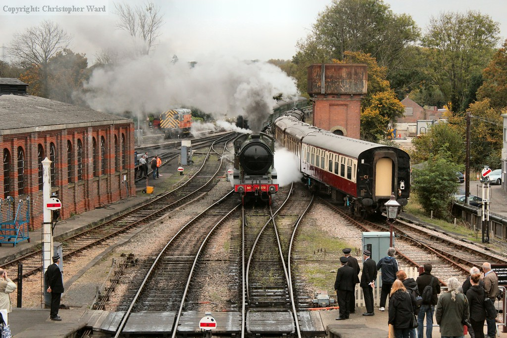 8572 pulls into the platform as her stock is shunted into the shed alongside