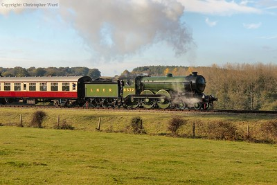 The B12 approaches Horsted Keynes with her first train of the morning