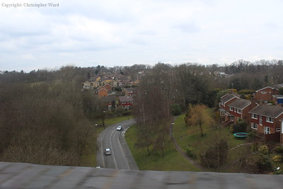 The view from the viaduct looking west. The road below is Garden Wood Road.