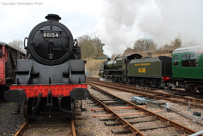 1638 passes the renumbered Standard Tank at the north end of Horsted platform