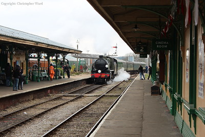 1638, with a wisp of steam from the injector, pulls into Horsted Keynes