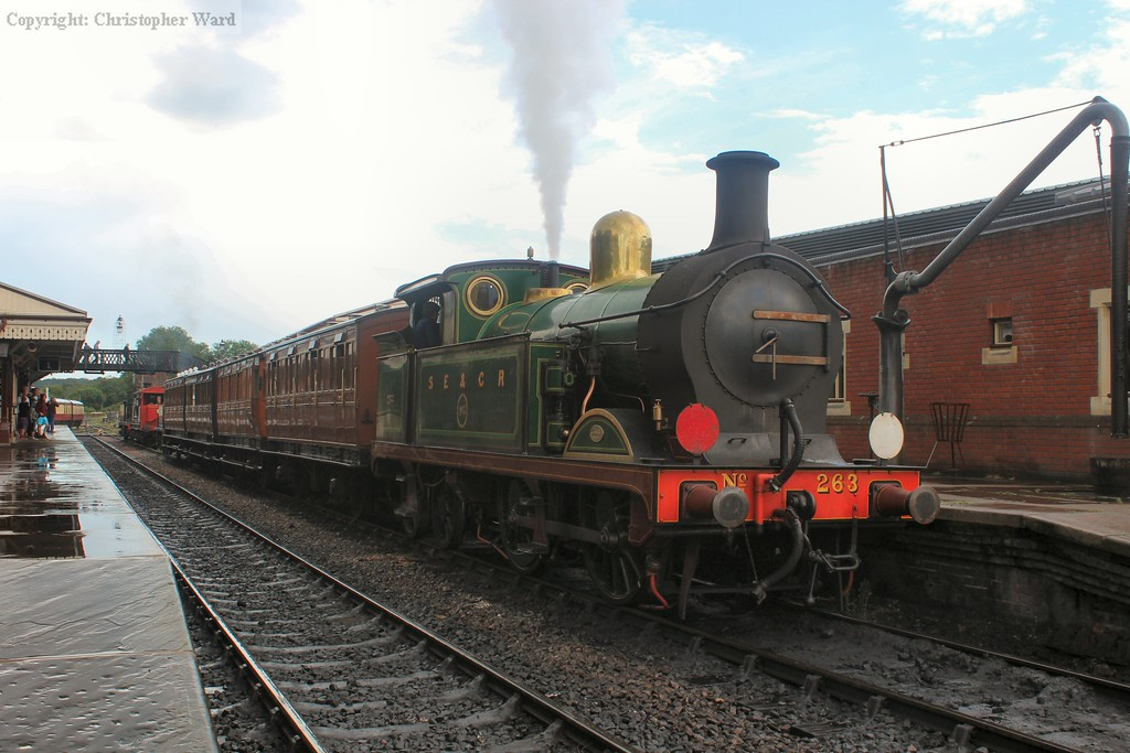 An unusual line-up in Platform 2 as the brake van shuttle with the C class shares it with the Horsted Keynes shuttle formed of the 4 wheelers and the P and H tanks