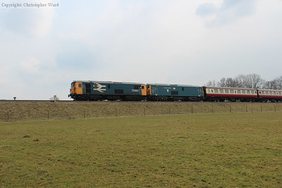 The sun briefly threatens an appearance as the 73s pull into Horsted