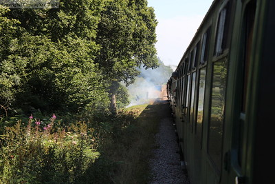 The train stops to deal with a line-side fire around half-way down Freshfield Bank on the return run to Sheffield Park