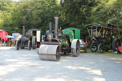 A selection of traction engines and steam rollers in the car park at Horsted Keynes