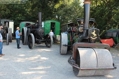A lovingly restored steam-roller and traction engine vie for attention