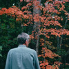 Randal Outside of Deck with Fall Colors - Oct. 2001